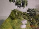 Hinter der Birke wird es noch einen höheren Baum geben und dazwischen Sträucher.